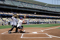 19 July 2009: NHL Kings mascot Bailey umpires for Jared Stoll before the MLB Los Angeles Dodgers 4-3 win over the Houston Astros on a warm summer day in LA at Chavez Ravine during a National League Professional Baseball game.