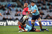 Nemani Nadolo tackled. NSW Waratahs v Canterbury Crusaders. Sport Rugby Union Super Rugby Representative Provincial. ANZ Stadium. 23 May 2015. Photo by Paul Seiser/SPA Images