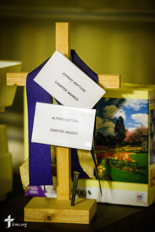 Name cards for Trinity Lutheran Church, Baton Rouge, La., charter members Althea Neptune and her deceased husband Johnny Neptune are salvaged from flood-damaged belongings in Althea's home on Wednesday,  Sept. 14, 2016, in Baton Rouge. LCMS Communications/Erik M. Lunsford