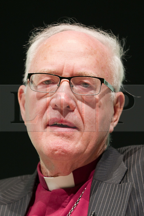 """© Licensed to London News Pictures. FILE PICTURE DATED 08/10/2012 of the former Archbishop of Canterbury , DR GEORGE CAREY , pictured at a Birmingham Town Hall meeting of The Coalition for Marriage as Lord Carey has today (30th March 2013) attacked Prime Minister David Cameron for making Christians feel marginalised . In an article for the Daily Mail , Lord Carey said the Prime Minister was """" aiding and abetting """" aggressive secularisation and that  """" more than two-thirds of Christians feel that they are part of a ' persecuted minority ' """" . Photo credit : Joel Goodman/LNP"""