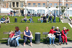 © Licensed to London News Pictures. 14/04/2013. Richmond, UK People relax and eat ice cream on benches. People enjoy the sunshine in Richmond, West London today 14th April 2013. Photo credit : Stephen Simpson/LNP