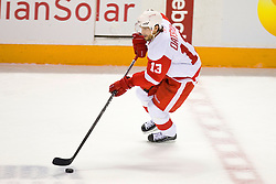 April 29, 2010; San Jose, CA, USA;  Detroit Red Wings center Pavel Datsyuk (13) against the San Jose Sharks during the first period of game one of the western conference semifinals of the 2010 Stanley Cup Playoffs at HP Pavilion. San Jose defeated Detroit 4-3. Mandatory Credit: Jason O. Watson / US PRESSWIRE