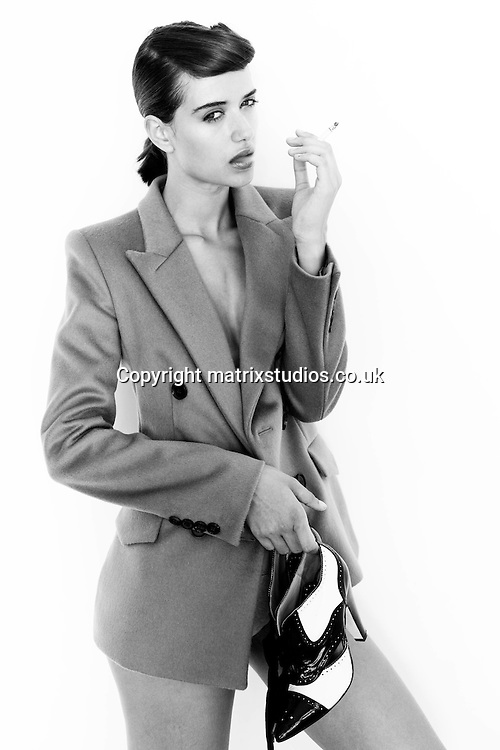 EXCLUSIVE PICTURE: MATRIXSTUDIOS.CO.UK.PLEASE CREDIT ALL USES..WORLD RIGHTS..***FEES TO BE AGREED BEFORE USE***..Fashion Model Aneu Smoking Shoot. .REF: ALI 122843