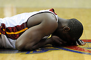 Feb 4, 2010; Cleveland, OH, USA; Miami Heat guard Dwyane Wade (3) lies on the floor after being hit in the face during the second quarter against the Cleveland Cavaliers at Quicken Loans Arena. Mandatory Credit: Jason Miller-US PRESSWIRE