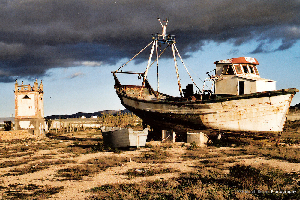 An old fishing boat on land in Cabo de Gata, Almeria, Spain