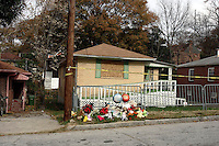 The home of Kathryn Johnston, an elderly woman who was allegedly shot to death by Atlanta police officers on Tuesday night, November 21, at 933 Neal Street. Authorities have said Johnston was 88 years old, while family and friends say she was 92. It was initially said that Johnston shot at officers when they broke down her front door on that night under a search warrant. They returned fire, killing her. The case is under investigation by the Federal Bureau of Investigation, the Georgia Bureau of Investigation and the Fulton County district attorney's office.