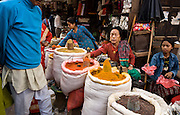 Women sell curry, turmeric and other spices on a street market in Kathmandu, the largest city in Nepal (700,000 people).