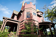 MADISON, WI — SEPTEMBER 2: An exterior view of Buell House at 115 Ely Place, featuring the crenelated parapet roof and rounded turret.