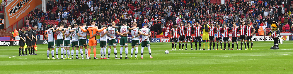 Barnsley and Sheffield United players observe the minutes silence in tribute to the Spanish attrocities
