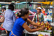 18 SEPTEMBER 2013 - BANGKOK, THAILAND: A fruit vendor in the Chinatown section of Bangkok. Thailand in general, and Bangkok in particular, has a vibrant tradition of street food and eating on the run. In recent years, Bangkok's street food has become something of an international landmark and is being written about in glossy travel magazines and in the pages of the New York Times.      PHOTO BY JACK KURTZ