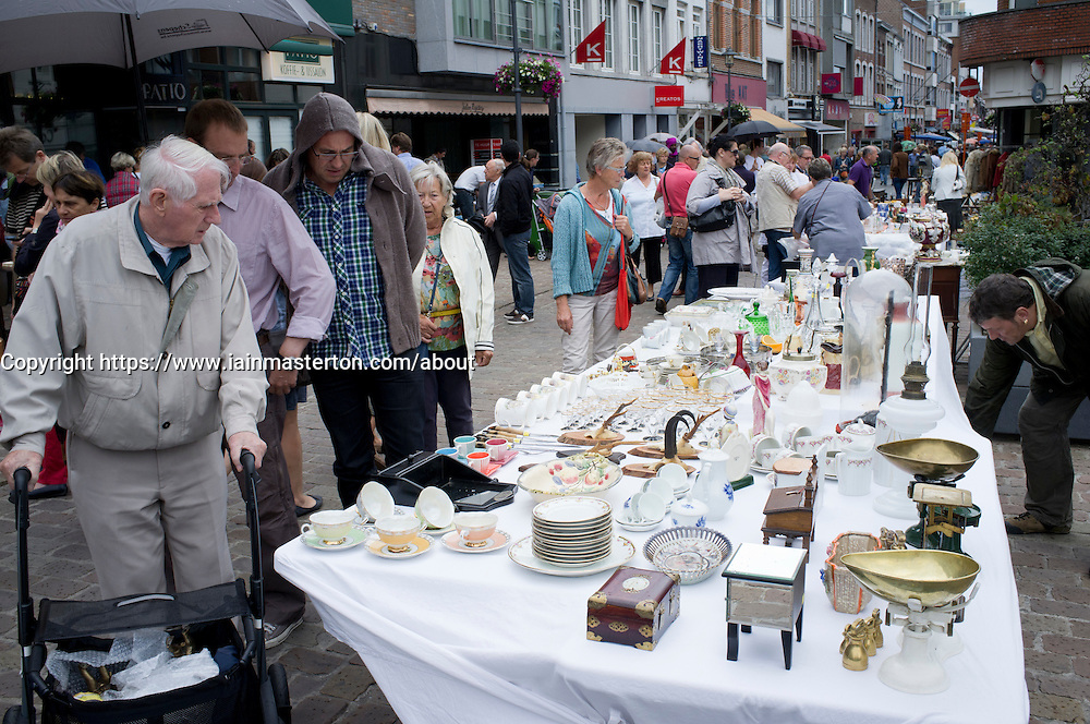 Sunday antiques market on street in Tongeren in Belgium
