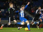 Brighton striker James Wilson shoots under pressure from Brentford midfielder Ryan Woods during the Sky Bet Championship match between Brighton and Hove Albion and Brentford at the American Express Community Stadium, Brighton and Hove, England on 5 February 2016. Photo by Bennett Dean.