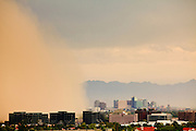 """18 AUGUST 2011 - PHOENIX, AZ:  A """"haboob"""" or dust storm moves from the suburb of Tempe to downtown Phoenix Thursday. A haboob (Arabic for """"strong wind"""") is a type of intense duststorm commonly observed in arid regions throughout the world. They have been observed in the Sahara desert, the Arabian Peninsula, throughout Kuwait, and most arid regions of Iraq. In the USA, they are frequently observed in the deserts of Arizona, including Yuma and Phoenix, as well as New Mexico and Texas. """"Haboob"""" has been widely used to describe dust storms for more than a generation In Arizona but this year the very word """"haboob"""" has become a political football because some conservatives have lobbied against use of the word, favoring English words, like """"dust storm.""""     PHOTO BY JACK KURTZ"""