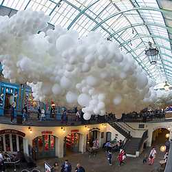 Covent Garden has commissioned artist Charles Pétillon to create a striking, large-scale installation, composed of 100,000 white balloons.The installation stretching 54 metres in length and 12 metres in width, incorporating gentle continuous pulsating white light to symbolise the beating of a heart. The work is titled 'Heartbeat'. will hang in the ceiling space of the South Hall Market Building.Pic Shows the Installation