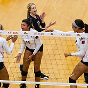 18 November 2017:  The San Diego State women's volleyball team closes out it's season against #24 Colorado State University. San Diego State defensive specialist Gabi Peoples (11) celebrates with her teammates after scoring a point in the first set. The Aztecs fell to the Rams in three sets. <br /> www.sdsuaztecphotos.com