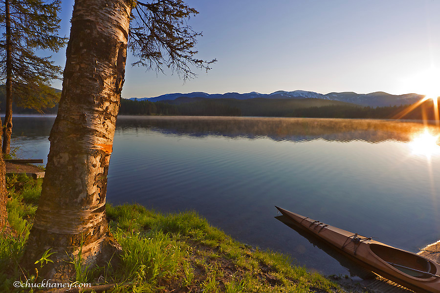 Sunrise on Beaver Lake in the Stillwater State Forest near Whitefish, Montana, USA