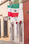 Mexican flags decorate the exterior of Talula de la Lune women's clothing boutique in the historic center of San Miguel de Allende, Mexico.