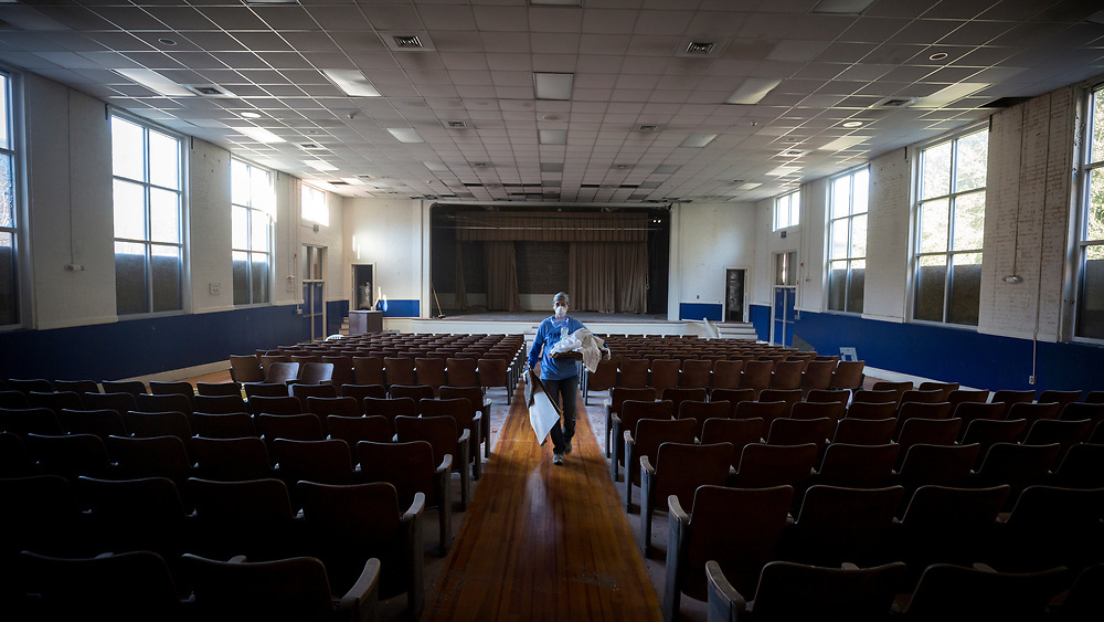 NOVEMBER, 17, 2017 - NORTH CHARLESTON, S.C.- U.S. Air Force Captain Althea Ridenour, with a group of United Way Day of Caring volunteers from the Air Force Joint Base Charleston, carry's debris from the auditorium at the the historic Chicora Graded School. (BNG/Stephen B. Morton)