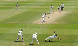 Somerset's Tom Abell survives a near catching chance as he places the ball just past the reach of Nottinghamshire's Steven Mullaney - Photo mandatory by-line: Harry Trump/JMP - Mobile: 07966 386802 - 16/06/15 - SPORT - CRICKET - LVCC County Championship - Division One - Day Three - Somerset v Nottinghamshire - The County Ground, Taunton, England.