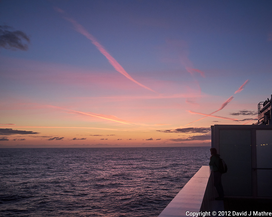 Pink Jet Contrails at Dawn over the North Atlantic Ocean from the Deck of MV Explorer. Image taken with a Leica X2 camera (ISO 400, 24 mm, f/4, 1/250 sec).