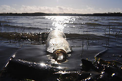 © Licensed to London News Pictures.19/01/2018<br /> Lamberhurst, UK.<br /> A plastic bottle floating in Bewl.<br /> BEWL WATER RESERVOIR drought weather.<br /> Southern Water have been granted a drought permit to fill up Bewl Water reservoir in Lamberhurst although in many parts of the UK its been a wet few months, The Environment Agency has given permission due to exceptionally low water levels.<br /> Photo credit: Grant Falvey/LNP