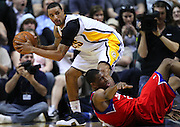 March 14, 2012; Indianapolis, IN, USA; Indiana Pacers shooting guard George Hill (3) picks up a loose ball as Philadelphia 76ers forward Thaddeus Young (21) falls at Bankers Life Fieldhouse. Indiana defeated Philadelphia 111-94. Mandatory credit: Michael Hickey-US PRESSWIRE