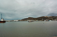 "(Image five of eight). Panorama of the Ensenada harbor in Mexico on a grey and raining day from the deck of the MV World Odyssey. The other cruse ship is the Carnival Imagination. Once all of the students, faculty, staff, and life long learners were aboard we would be ready to begin the 102 day ""round the world"" Semester at Sea Spring 2016 Voyage. Composite of eight images taken with a Nikon N1 V3 camera and 10-30 mm lens (ISO 200, 10 mm, f/11, 1/250 sec). Panorama stitched using AutoPano Giga Pro."