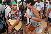 10 SEPTEMBER 2003 - CANCUN, QUINTANA ROO, MEXICO: An indigenous woman from Mexico and an anti-WTO protester at a protest against the WTO in Cancun. Tens of thousands of protesters, mostly farmers, came to Cancun for the fifth ministerial of the World Trade Organization (WTO). They were protesting against developed nations pushing to get access to agricultural markets in developing nations. The talks ultimately collapsed after no progress with no agreements reached between the participants.           PHOTO BY JACK KURTZ