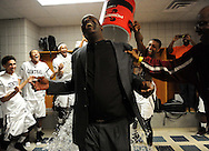 Beaumont Central head coach Robert Lee is doused with water by E'Torrion Wilridge following the Jaguars' 67-57 victory over Marshall in the Class 4A Region 3 Final high school basketball playoff game, Saturday, March 1, 2014, at Merrill Center in Katy, TX.