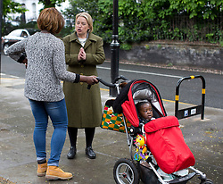 © Licensed to London News Pictures. 03/05/2015. London, UK. Natalie Bennett, Leader of the Green Party of England and Wales, talks to a supporter in a canvassing day  in Islington, London. Photo credit: LNP