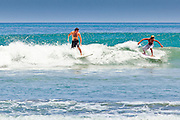 Apr 24 - KUTA, BALI - Tourists surf on Kuta beach, one of Bali's most famous beaches in Kuta, Bali, Indonesia. Photo by Jack Kurtz/ZUMA Press
