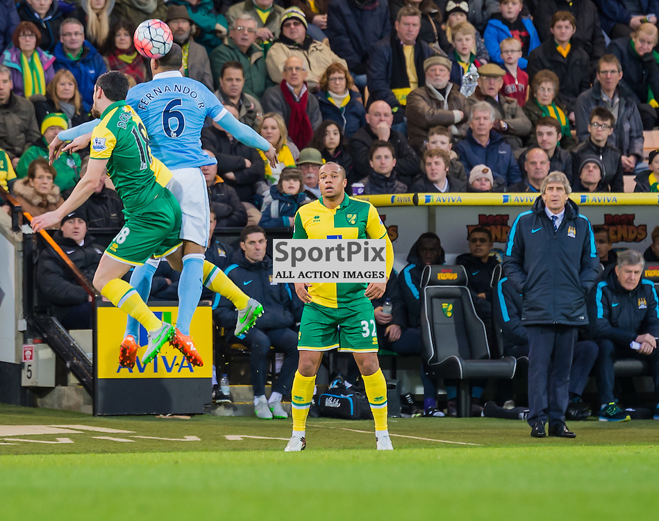 Norwich City midfielder Graham Dorrans (18) and Manchester City midfielder Fernando (6) challenge for a header in midfield