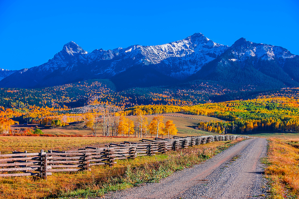 Fence line, Last Dollar Ranch, Last Dollar Road between Ridgway and Telluride (with the Sneffels Range in background), Colorado USA.