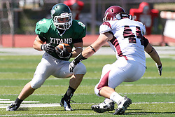 08 September 2012:  T.J. Stinde gets challenged by Donald Morin during an NCAA division 3 football game between the Alma Scots and the Illinois Wesleyan Titans which the Titans won 53 - 7 in Tucci Stadium on Wilder Field, Bloomington IL