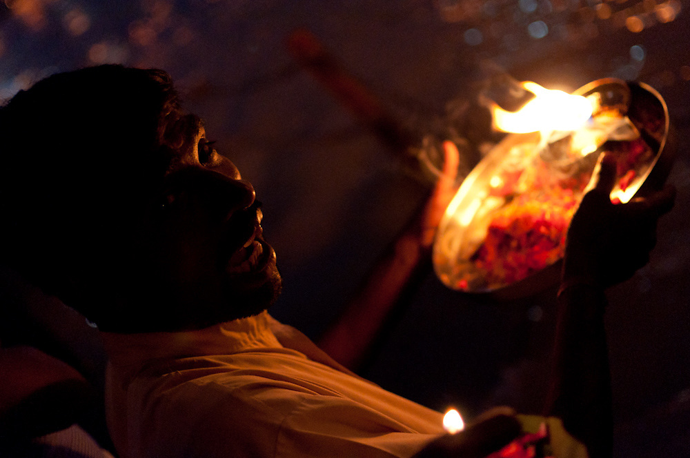 Lighting candles in flower baskets for 'ganga aarti' puja on the Ganges in Haridwar