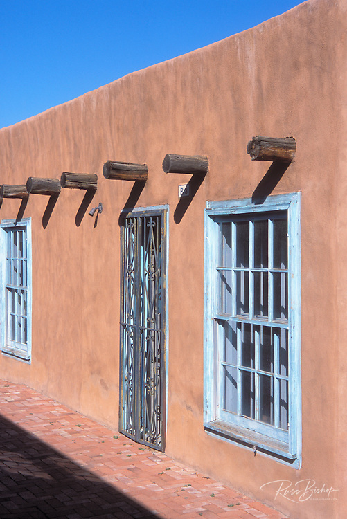Morning light on adobe building under blue sky, Old Town, Albuquerque, New Mexico