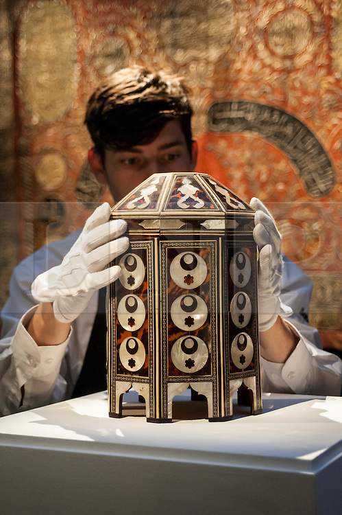 © Licensed to London News Pictures. 02/10/2015. London, UK. A Sotheby's technician shows a magnificent Ottoman Tortoiseshell and Pearl Box, circa 1640 (est £70k - 100k) at the preview of Indian and Islamic Art Week at Sotheby's which runs from 2 to 7 October.   Photo credit : Stephen Chung/LNP