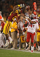 October 9 2010: Iowa State Cyclones cornerback Leonard Johnson (23) and Utah Utes wide receiver Reggie Dunn (14) battle for a pass during the first half of the NCAA football game between the Utah Utes and the Iowa State Cyclones at Jack Trice Stadium in Ames, Iowa on Saturday October 9, 2010. Utah defeated Iowa State 68-27.