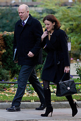 © Licensed to London News Pictures. 26/11/2013. London, UK. The Justice Secretary, Chris Grayling (L), arrives with the Northern Ireland Secretary, Theresa Villiers, for a meeting of British Prime Minister David Cameron's Cabinet on Downing Street in London today (26/11/2013). Photo credit: Matt Cetti-Roberts/LNP