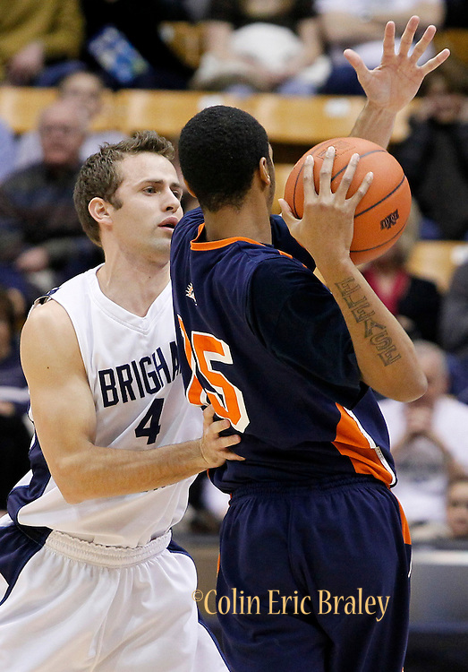 BYU guard Jackson Emery (4) pressures Fresno Pacific forward Deshaun Legree (15) during the first half of an NCAA college basketball game, Saturday, Jan. 1, 2011, in Salt Lake City. (AP Photo/Colin E Braley)