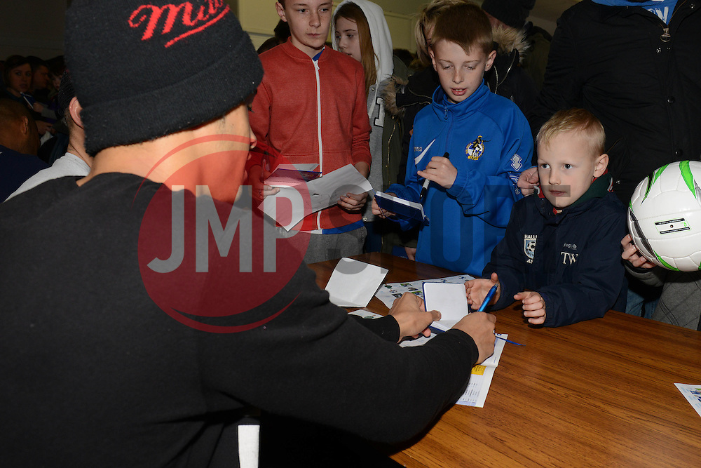 Bristol Rovers players sign autographs in the clubhouse after their open training session - Photo mandatory by-line: Dougie Allward/JMP - Mobile: 07966 386802 - 31/03/2015 - SPORT - Football - Bristol - Memorial Stadium - Vanarama Football Conference - Bristol Rovers Open Training Session