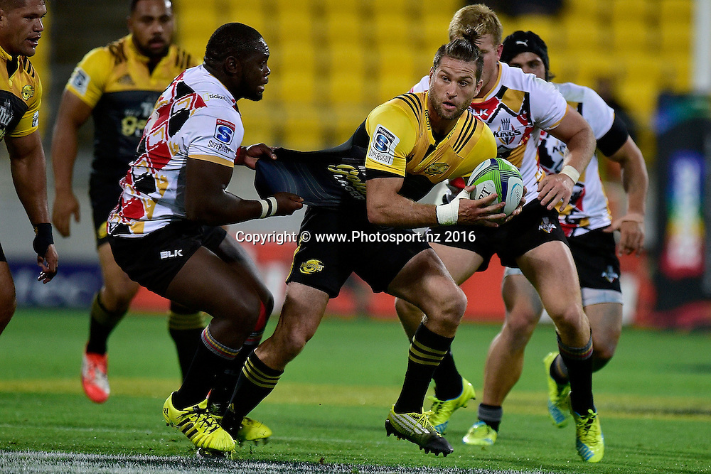 Cory Jane (R of the Hurricanes looks to pass as he is tackled by Sti Sithole of the Southern Kings during the Hurricanes vs Kings Super Rugby  match at the Westpac Stadium in Wellington on Friday the 25th of March 2016. Copyright Photo by Marty Melville / www.Photosport.nz