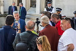 London, UK. 18 September, 2019. Jolyon Maugham QC debates with Brexit supporters outside the Supreme Court at lunchtime on the second day of a hearing to consider whether Prime Minister Boris Johnson broke the law by proroguing Parliament in advance of Brexit Day.