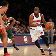 Raymond Felton, New York Knicks, drives to the basket  during the New York Knicks vs Milwaukee Bucks, NBA Basketball game at Madison Square Garden, New York. USA. 15th March 2014. Photo Tim Clayton