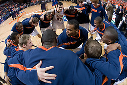 Virginia's Adrian Joseph (center) helps to get the Cavaliers ready for their game against Wake Forest.  The Virginia Cavaliers defeated the Wake Forest Demon Decons 88-76 at the John Paul Jones Arena in Charlottesville, VA on January 21, 2007.