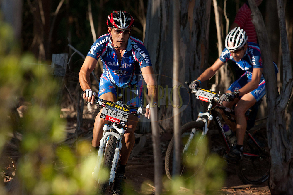 A team of two riders  head out onto the course in the early morning light during the Prologue of the 2011 Absa Cape Epic Mountain Bike stage race held at the Chrysalis Academy in Tokai Forest outside Cape Town, South Africa on the 27 March 2011..Photo by Greg Beadle/Cape Epic/SPORTZPICS