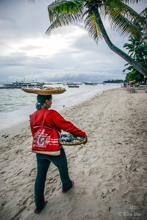The beach vendor in red, Panglao Island, Philippines