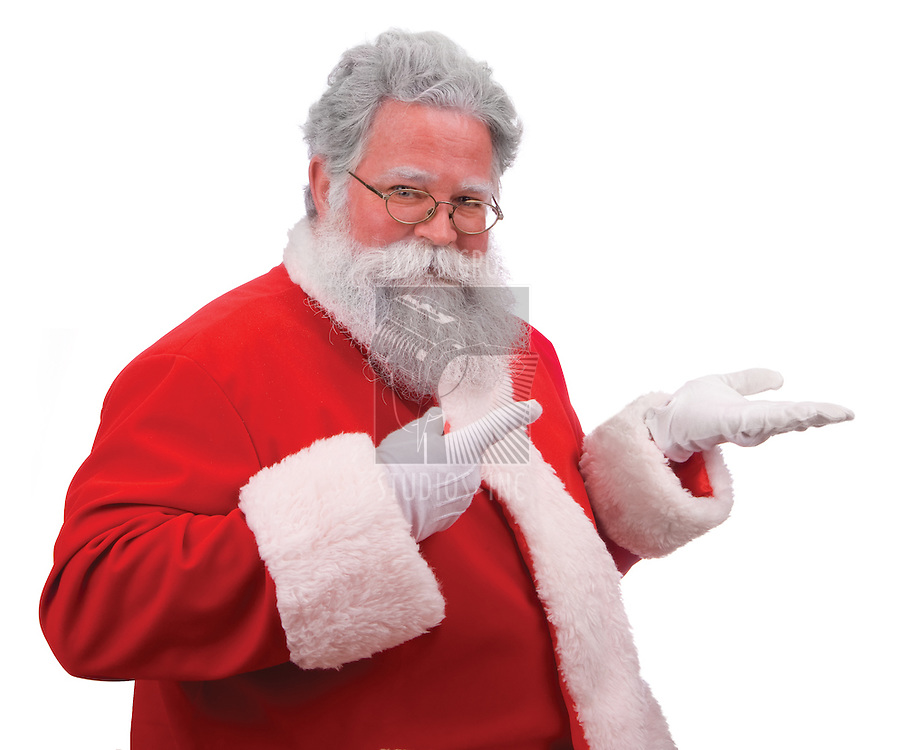 Santa pointing as if displaying a product on on the palm of his hand against a white background