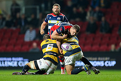 Ian Evans of Bristol Rugby spills the ball as Josh Turnbull and Scott Andrews of Cardiff Blues tackle - Rogan Thomson/JMP - 14/10/2016 - RUGBY UNION - Ashton Gate Stadium - Bristol, England - Bristol Rugby v Saracens - EPCR Challenge Cup.