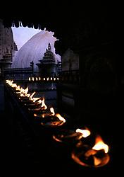 NEPAL KATHMANDU APR95 - Butter lamps burn at the Shwayambunath Hindu Temple in Kathmandu. Nepal is the only Hindu kingdom in the world. <br /> <br /> jre/Photo by Jiri Rezac<br /> <br /> © Jiri Rezac 1995<br /> <br /> Tel: +44 (0) 7050 110 417<br /> Email: info@jirirezac.com<br /> Web: www.jirirezac.com